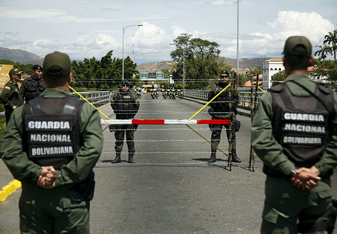 Colombia's soldiers stand in front of Venezuela's National Guards at Simon Bolivar international bridge, on the border with Colombia, at San Antonio in Tachira state