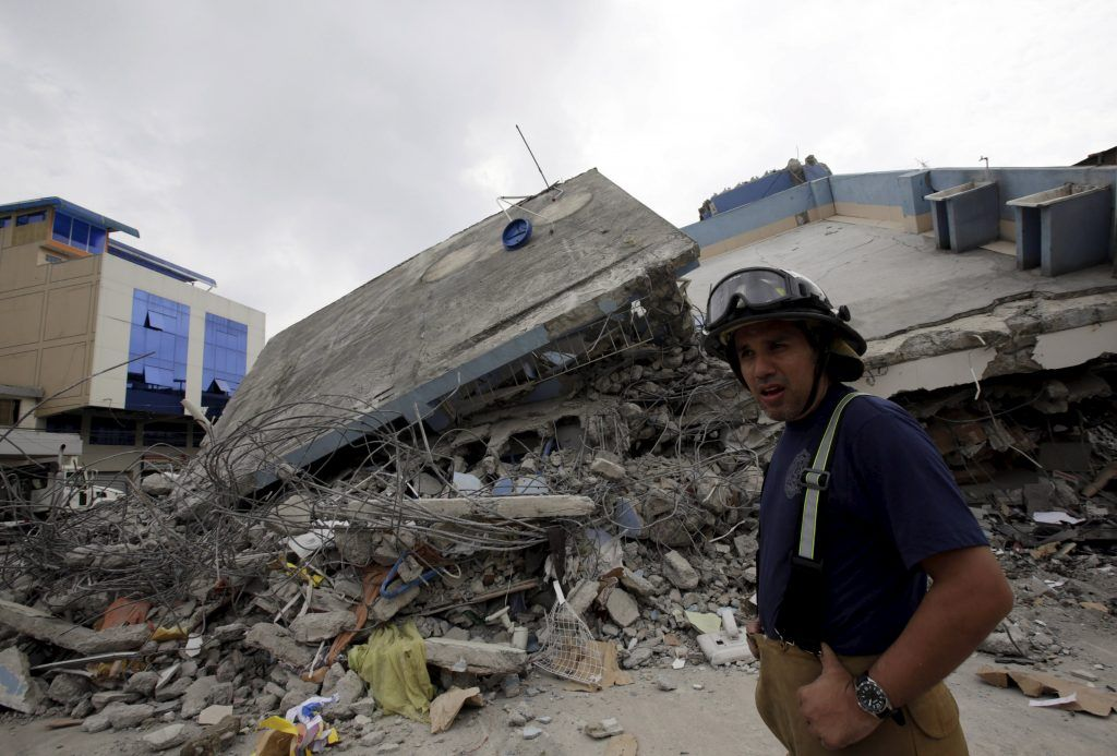 A firefighter walks past a collapsed building after an earthquake struck off the Pacific coast, in Guayaquil, Ecuador, April 17, 2016. REUTERS/Henry Romero